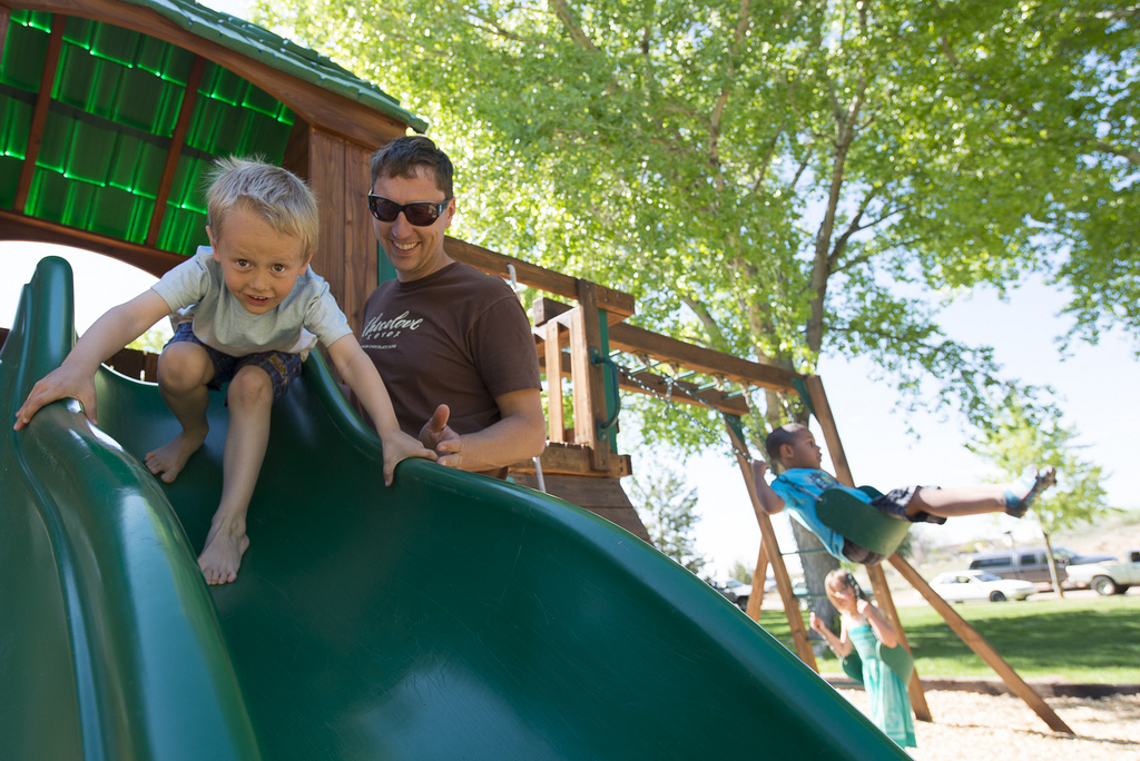 parent and child on slide