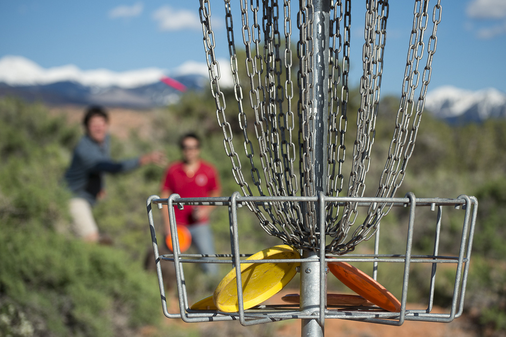 People playing disc golf